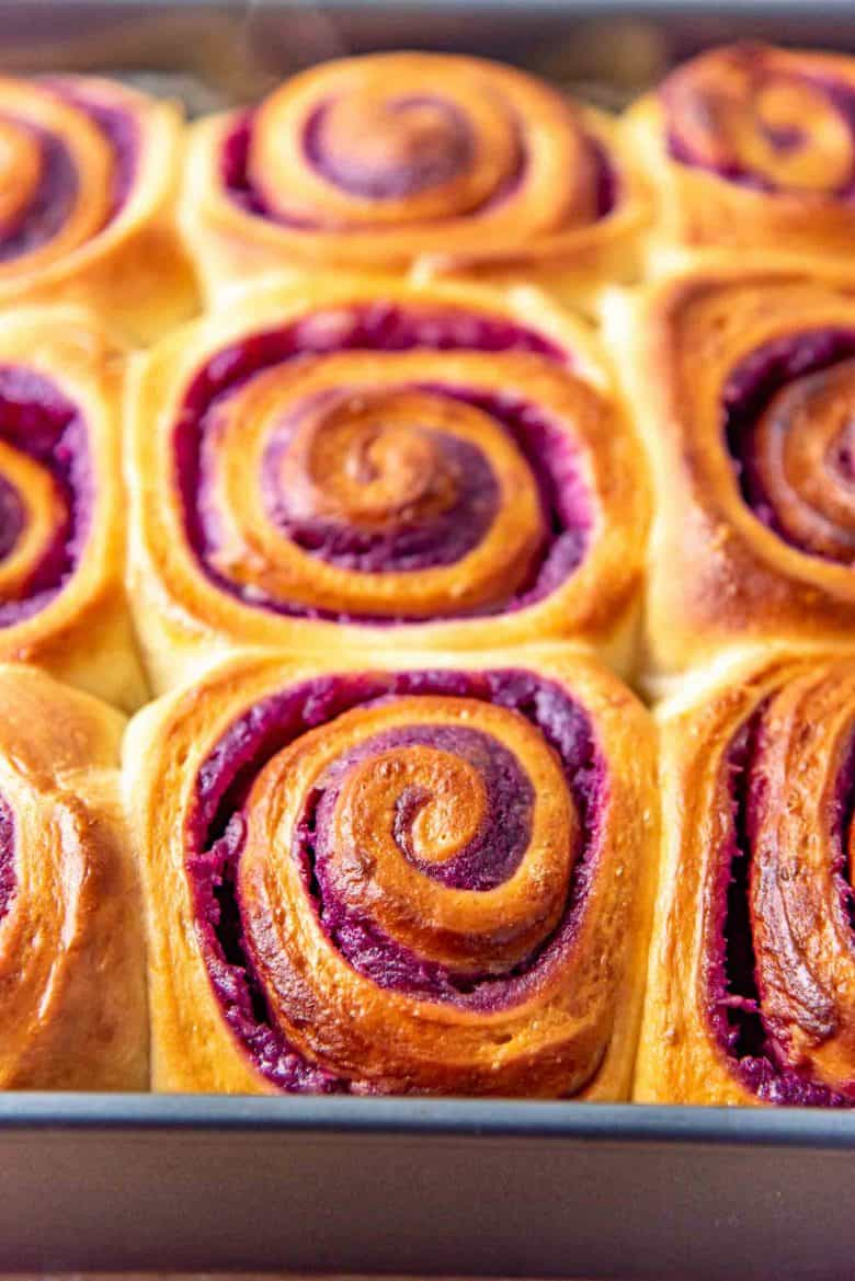 Freshly baked swirled ube bread rolls