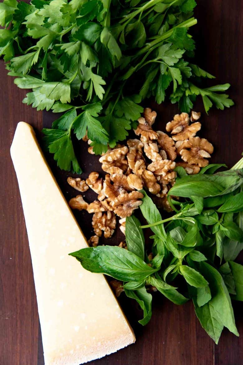 Ingredients needed for a walnut parsley pesto