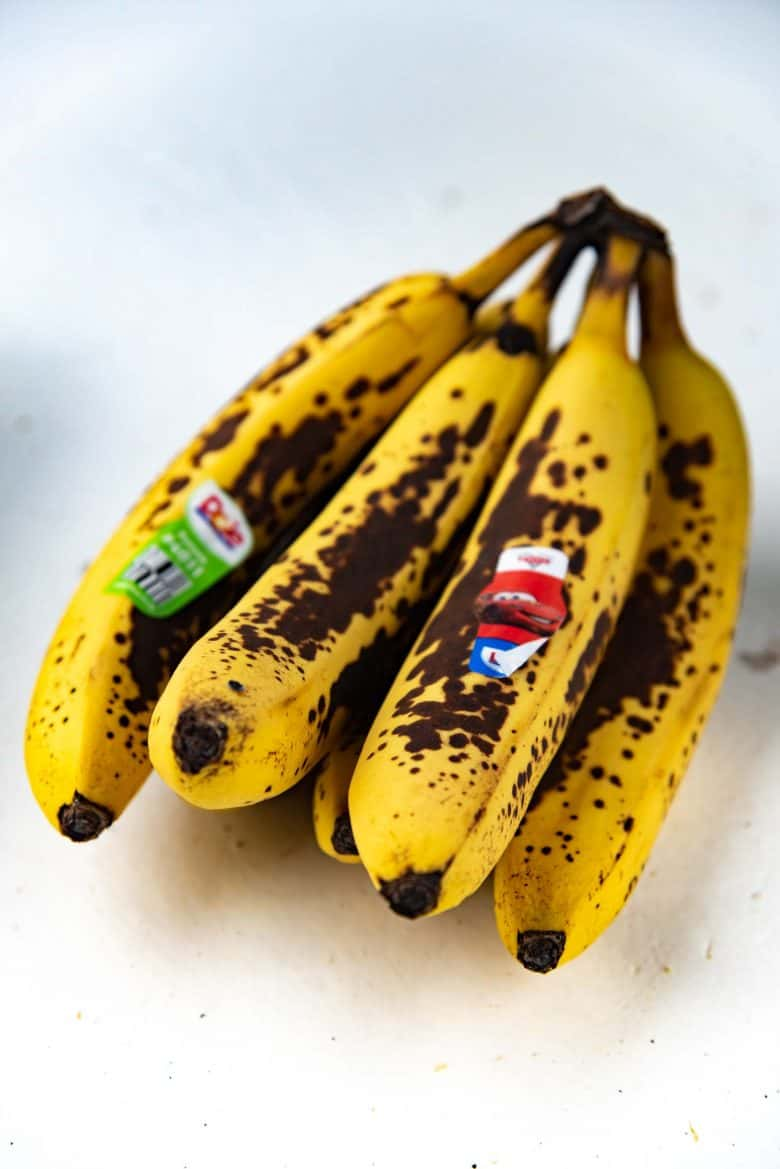 Overripe bananas on a white tabletop