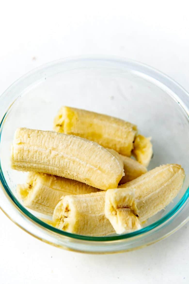 Peeled ripe bananas in a bowl