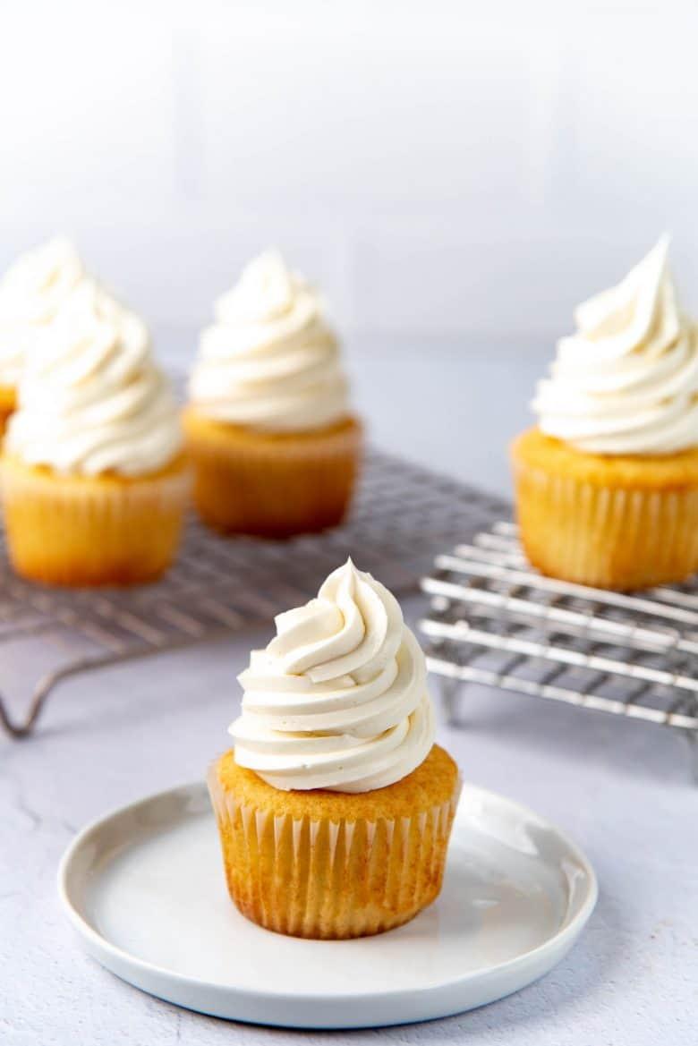 Vanilla cupcakes topped with vanilla swiss meringue buttercream