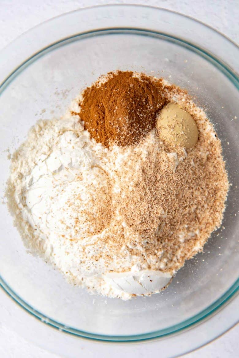 Dry ingredients in a bowl for pumpkin cake roll