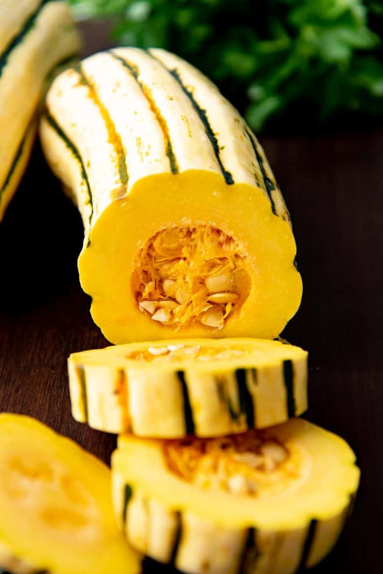 Rings being cut from a delicata squash