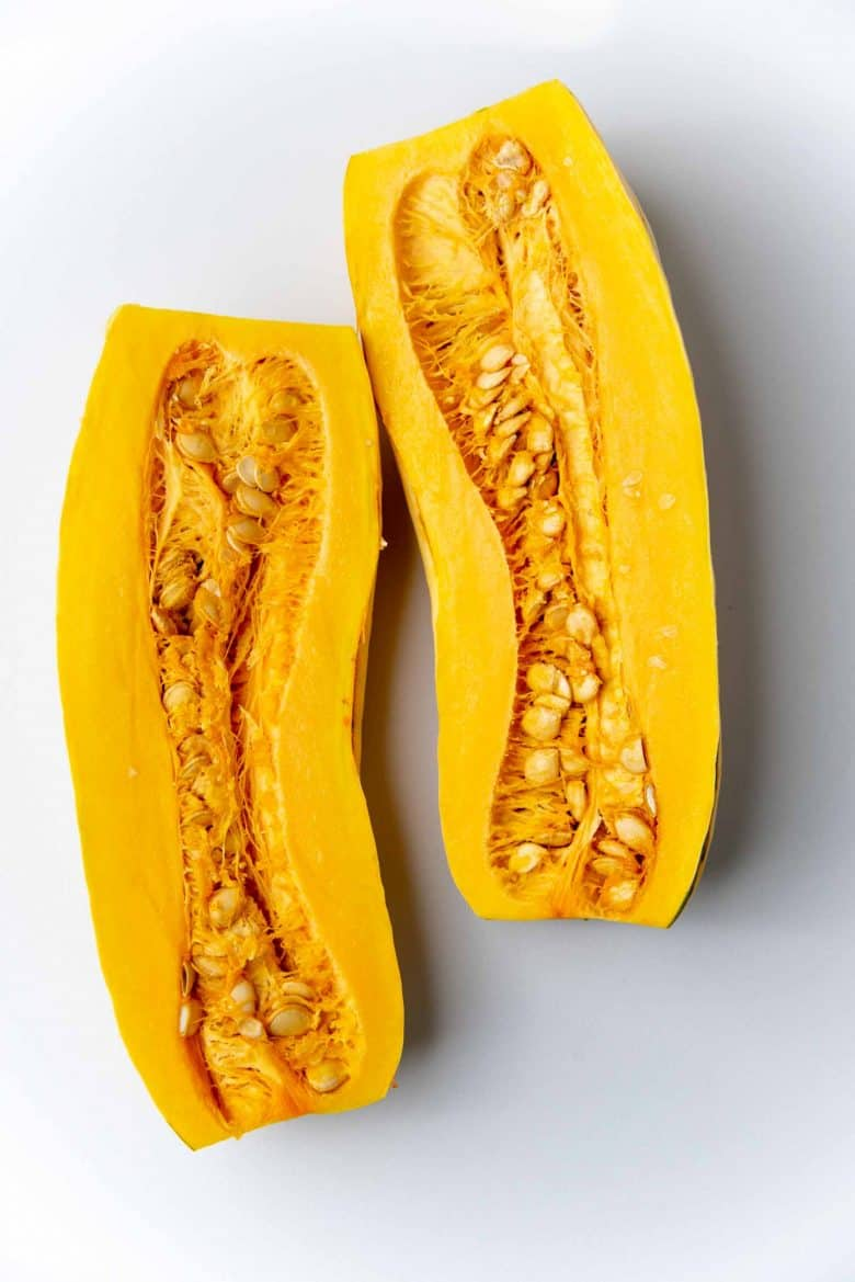 Delicata squash that has been sliced lengthways