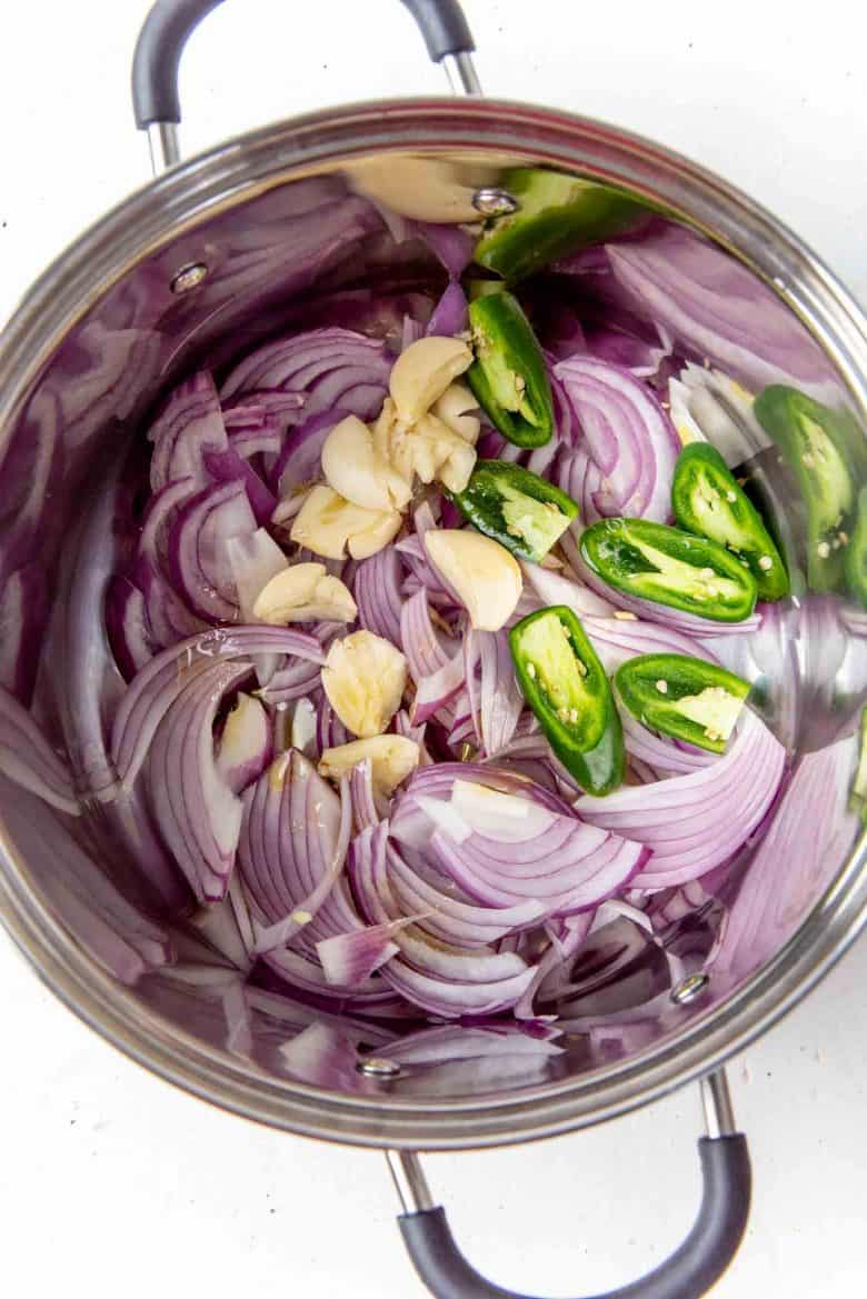 Onions, garlic and other ingredients in a large pot