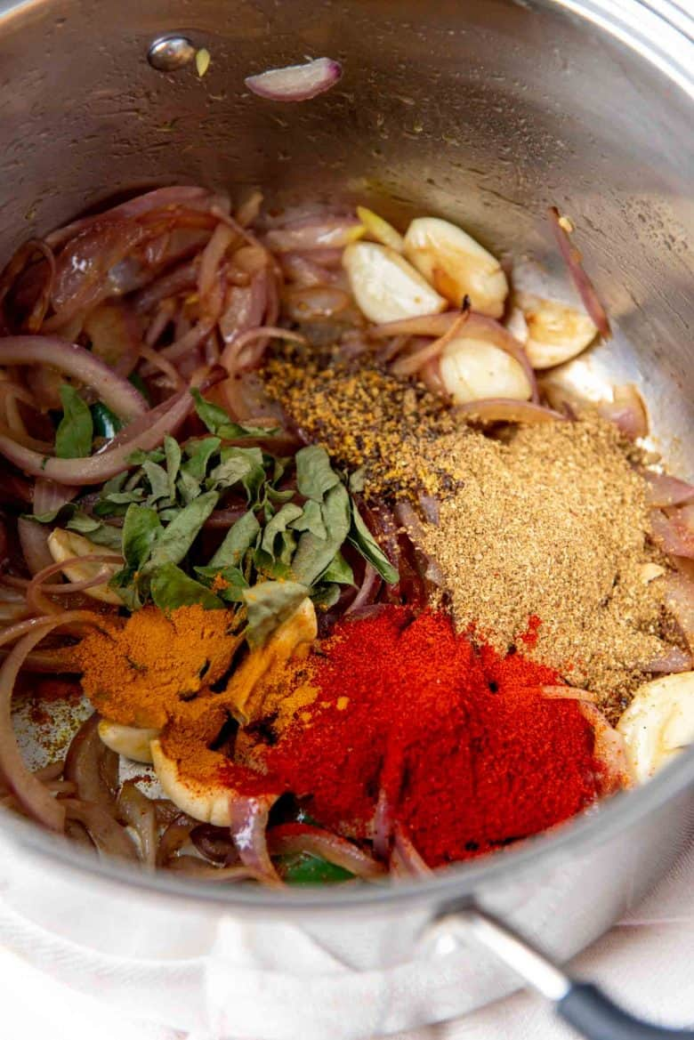 Spices added to the softened onions in the large pot
