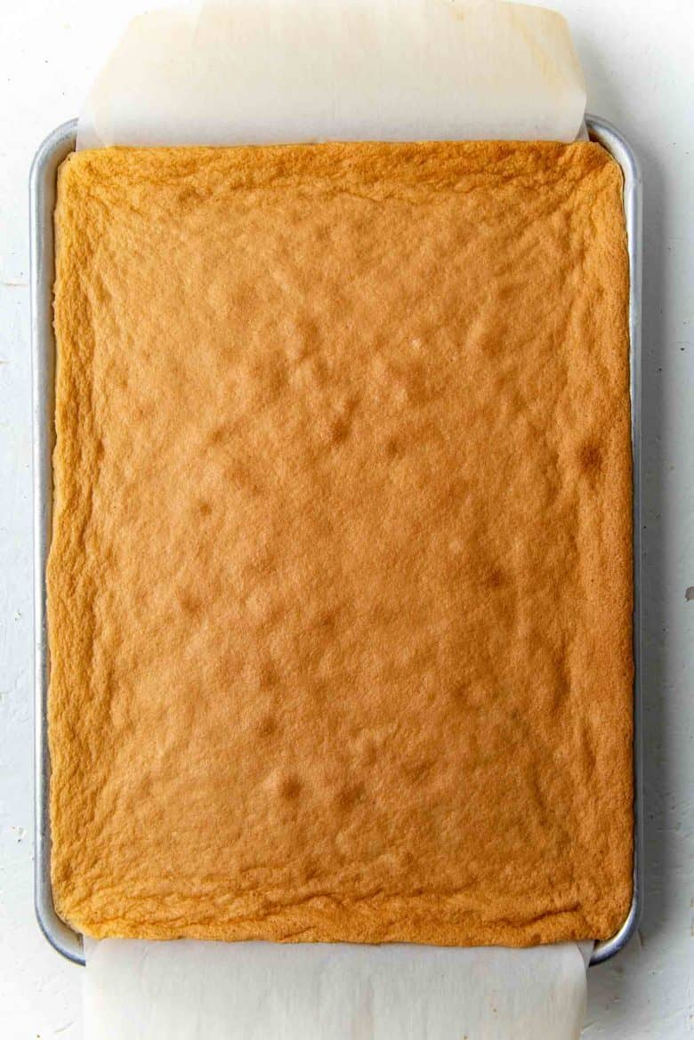 Overhead view of freshly baked cake roll sheet