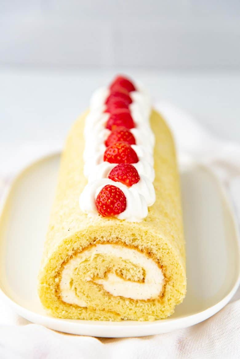 Swiss roll decorated with strawberries on top
