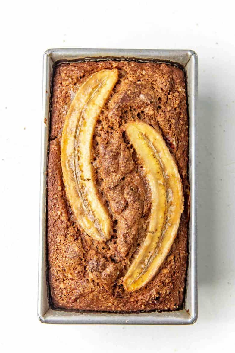 A freshly baked whole wheat banana bread overhead view