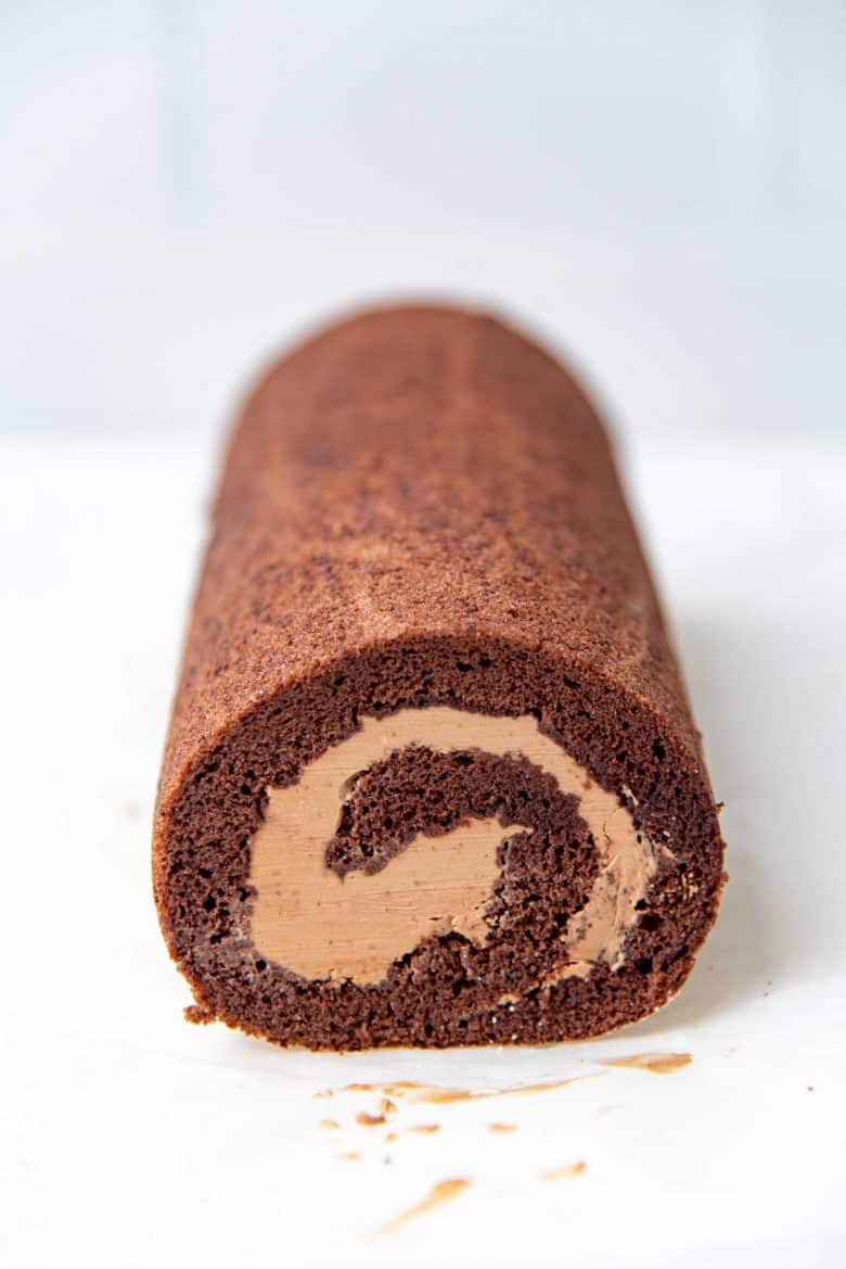 A rolled chocolate swiss roll after edges trimmed