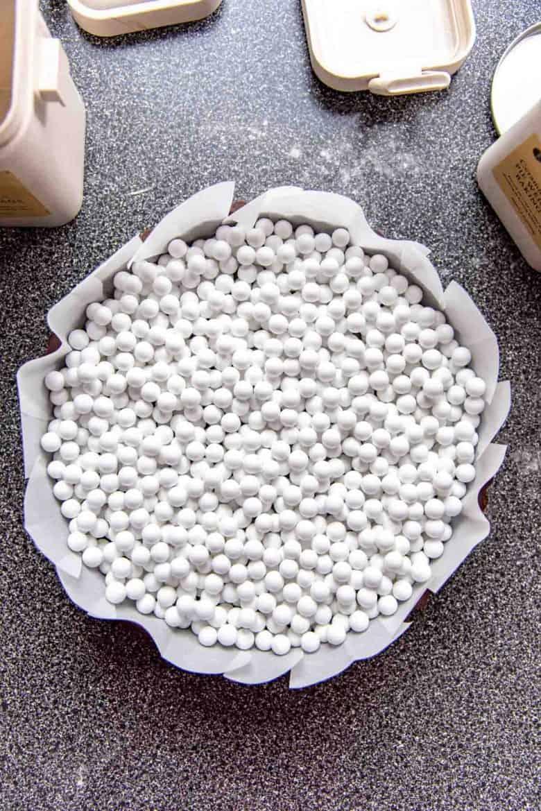 Pie weights inside a tart shell