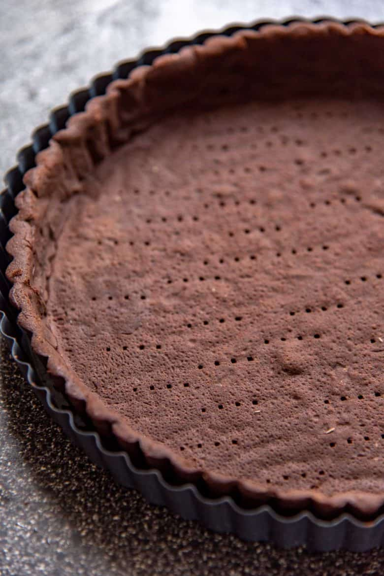A baked chocolate pate sucree tart