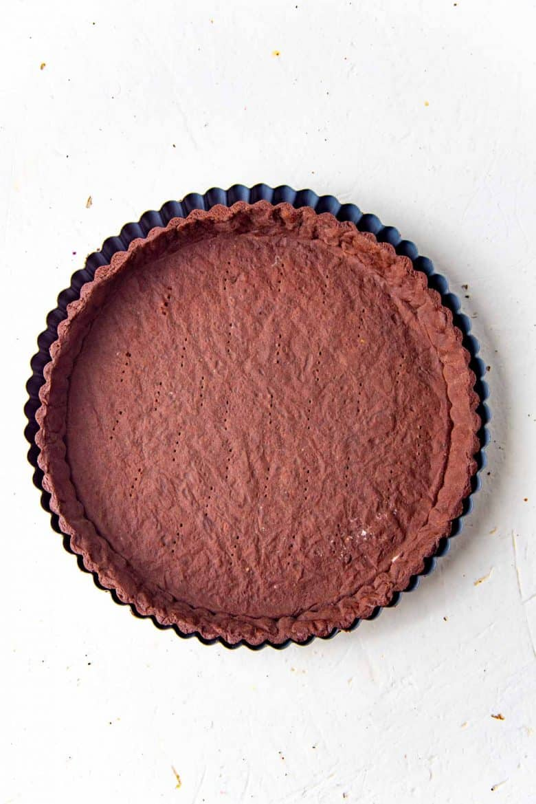 A freshly baked chocolate pate sucree tart shell