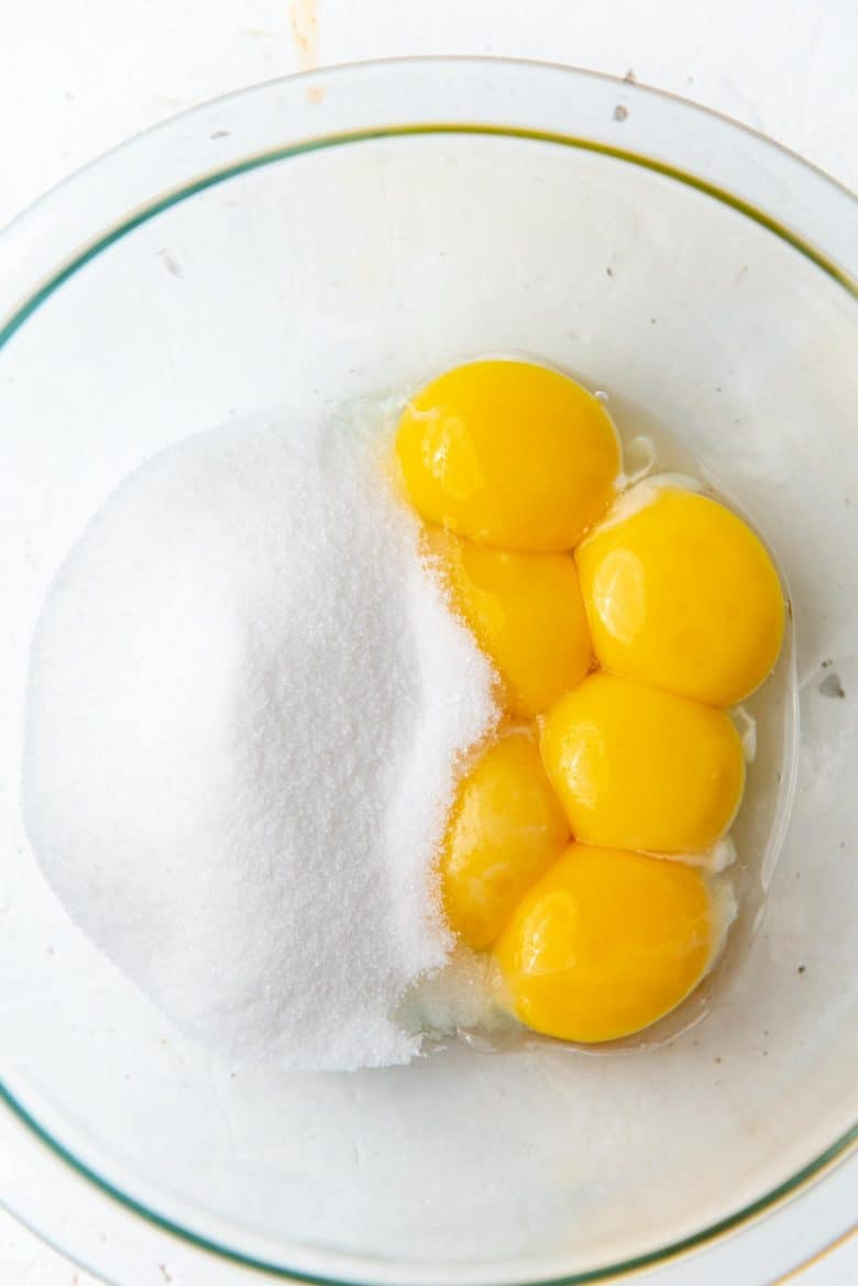 Egg yolks and sugar in a bowl