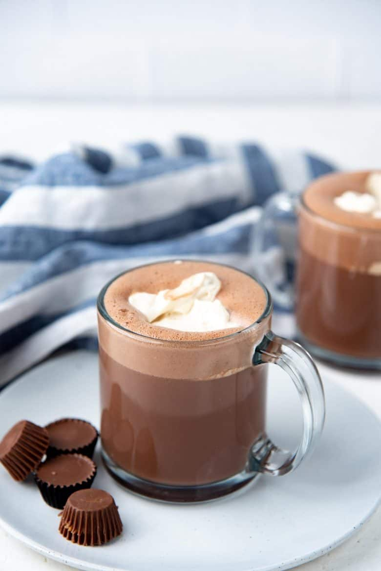 A peanut butter hot chocolate with peanut butter whipped cream