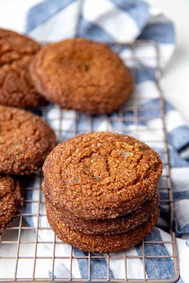 A stack of  chewy soft ginger cookies on a wire rack