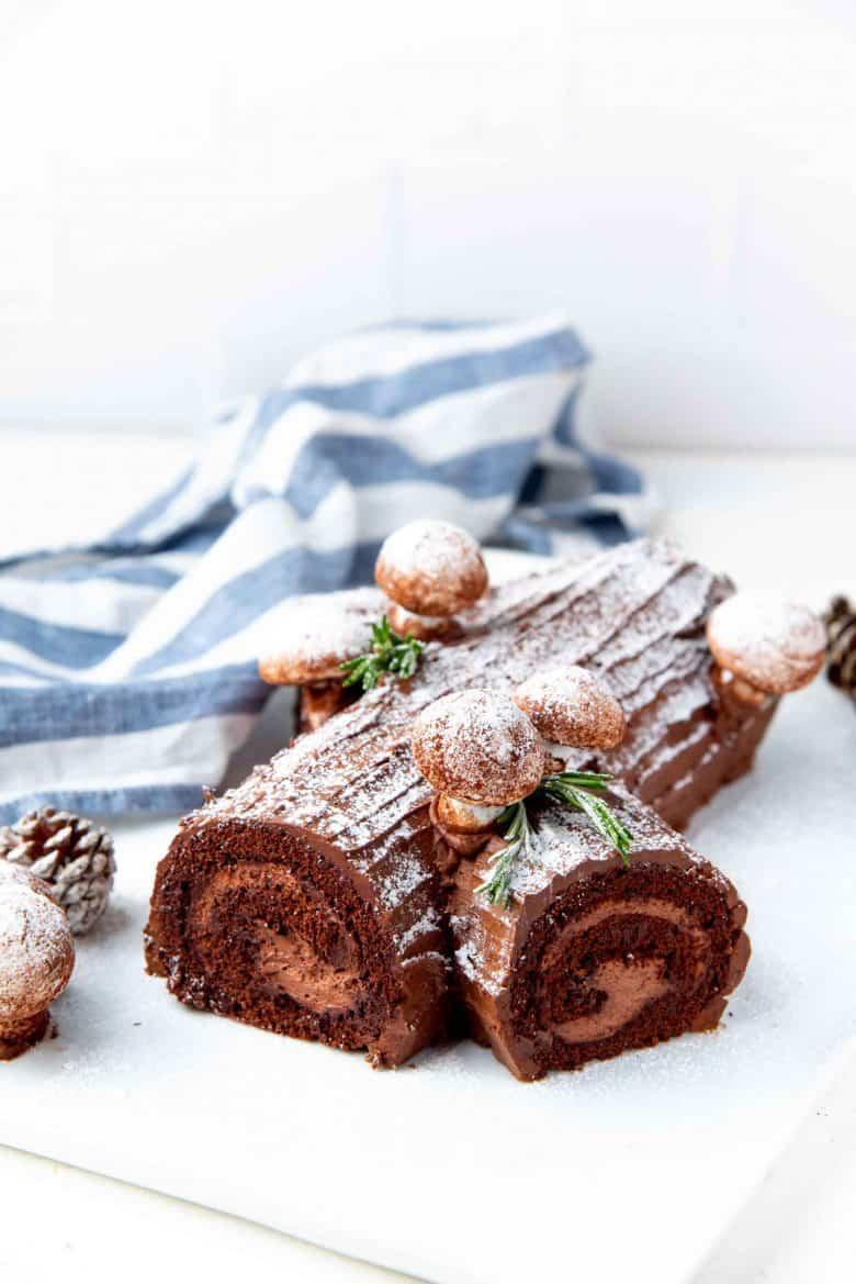Branched Bûche de Noël (yule log cake) on a white serving platter
