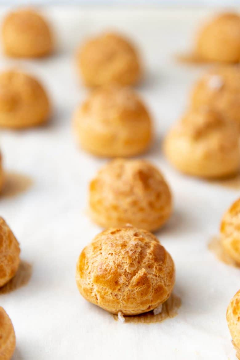 Freshly baked choux pastry on the baking sheet
