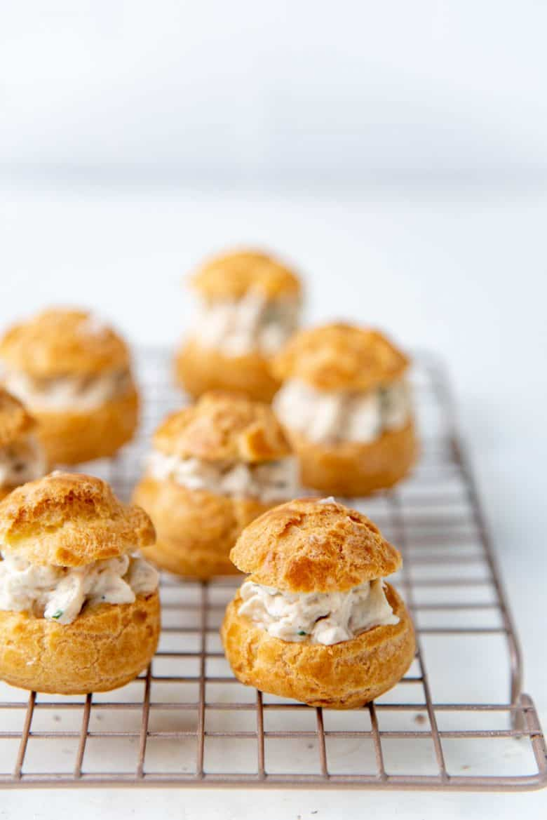 The chicken filled choux pastry on a wire rack