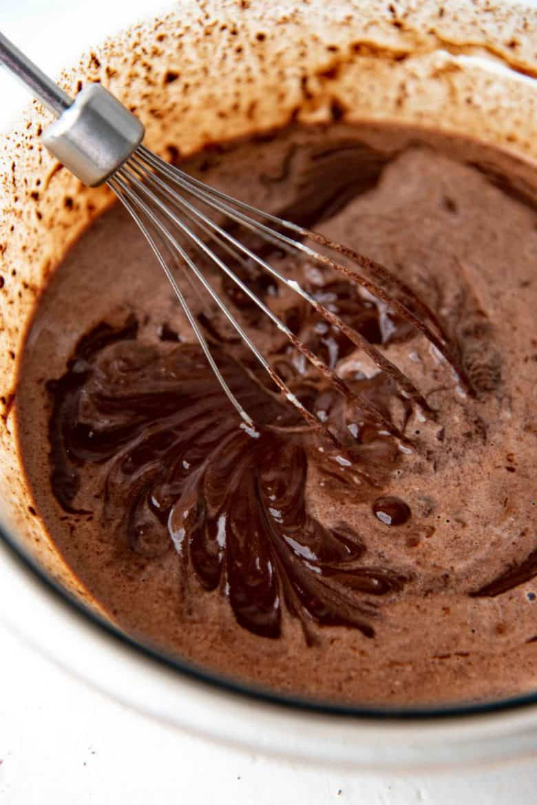 Whisking to melt and combine the chocolate and cream mixture