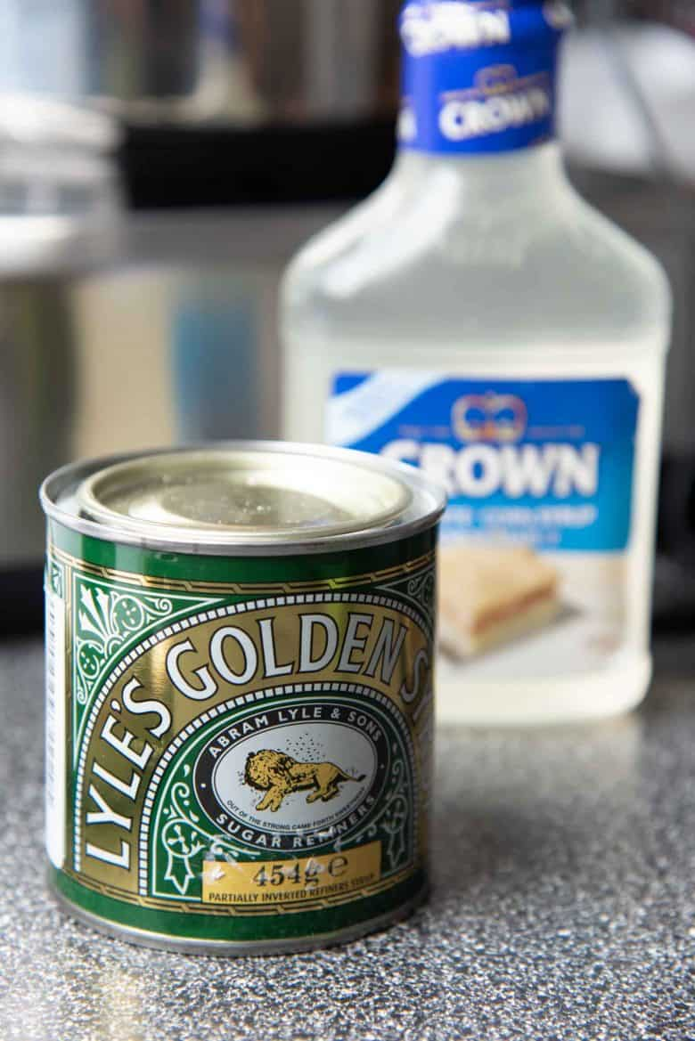 Golden syrup and corn syrup on a counter top