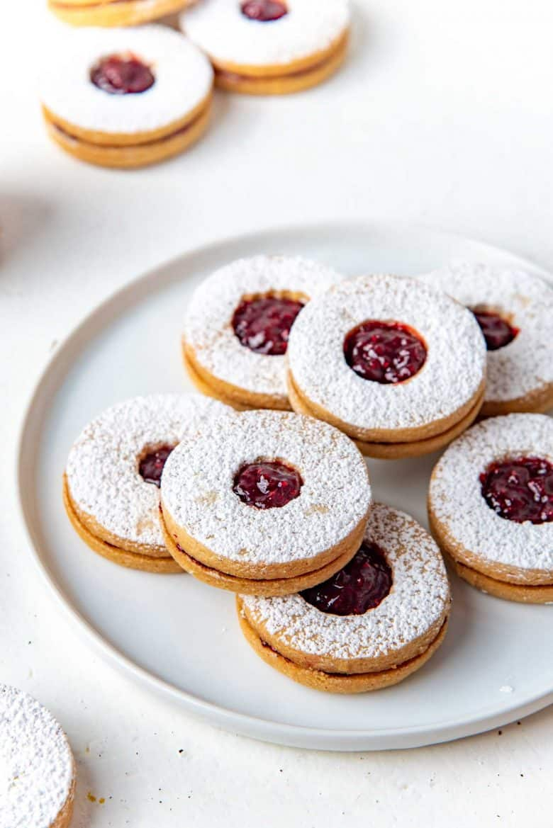 Linzer cookies served on a white plate