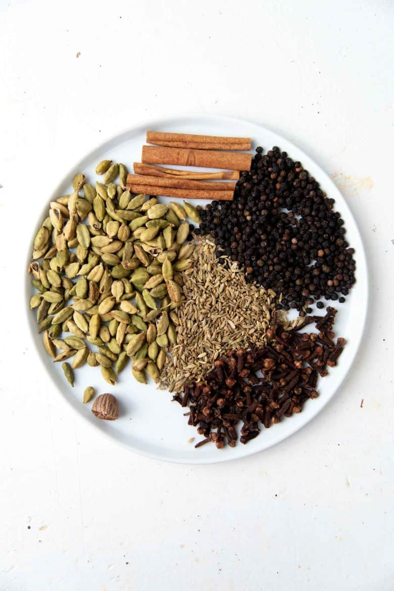 Whole spices used to make the spice mix for the tea