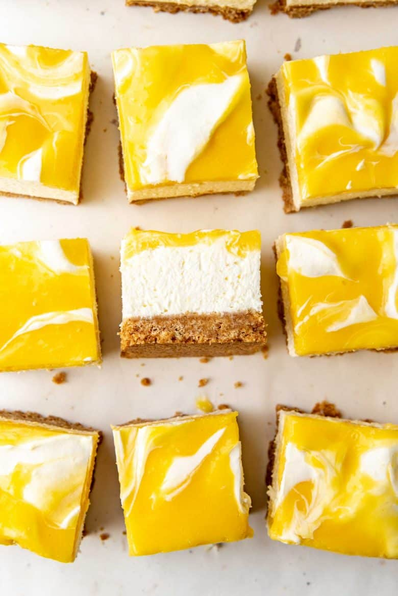 Swirled lemon cheesecake, overhead view with one slice on its side