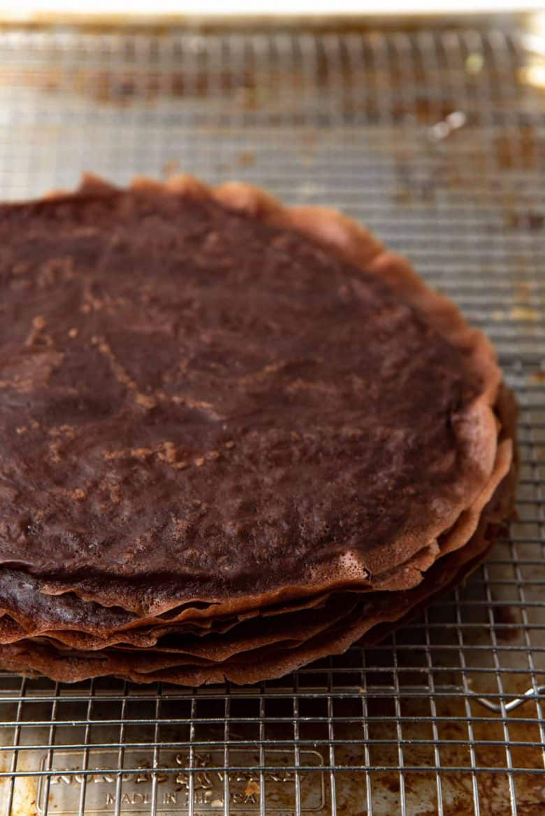Chocolate crepes with lacy edges stacked on top of each other