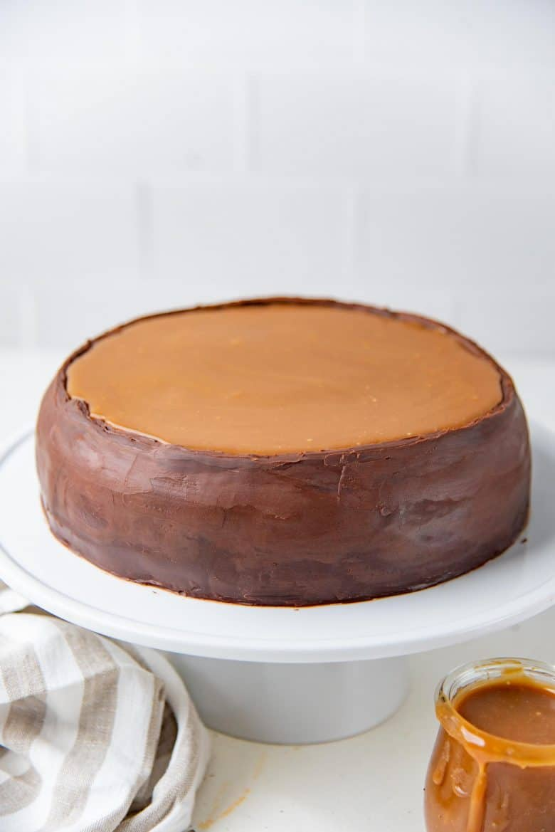 Salted caramel chocolate crepe cake with the caramel sauce on top