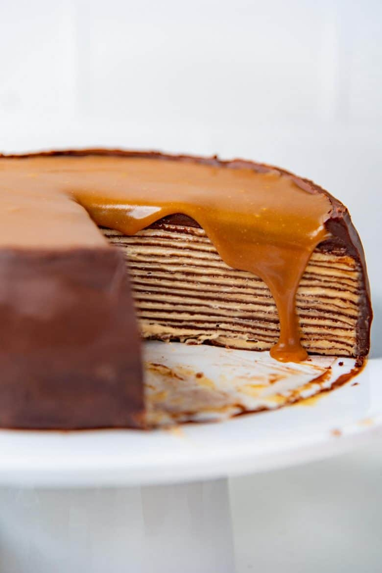 A close up of the crepe cake on a cake stand