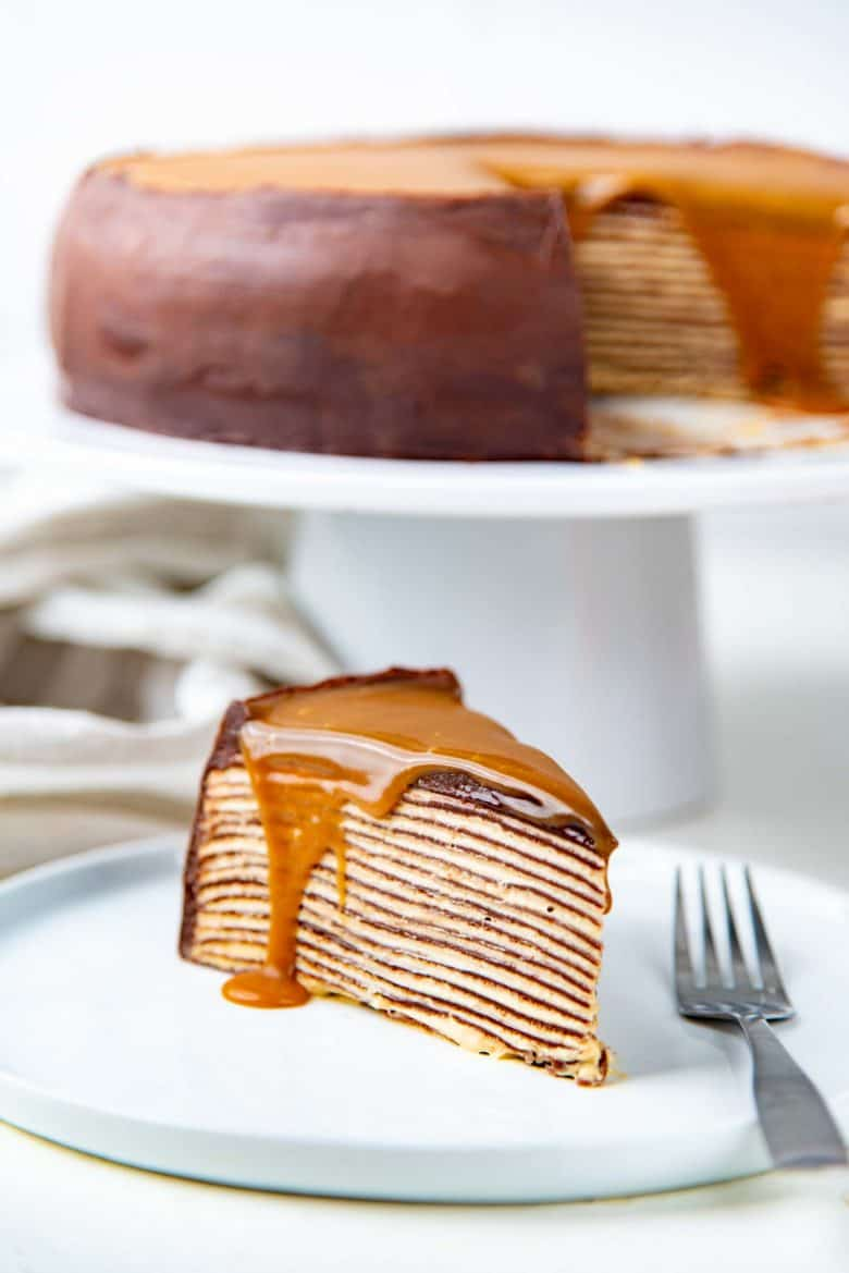 A no bake crepe cake with salted caramel on top