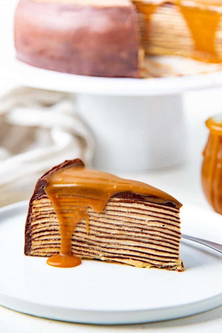A slice of the chocolate crepe cake on a plate