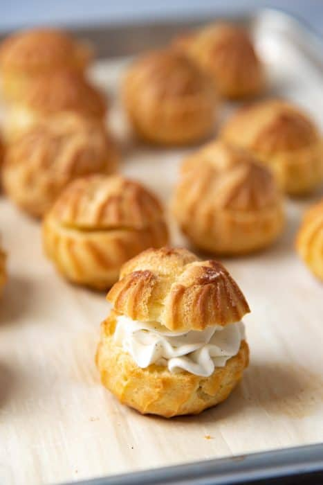 The top placed back on the cream filled choux pastry