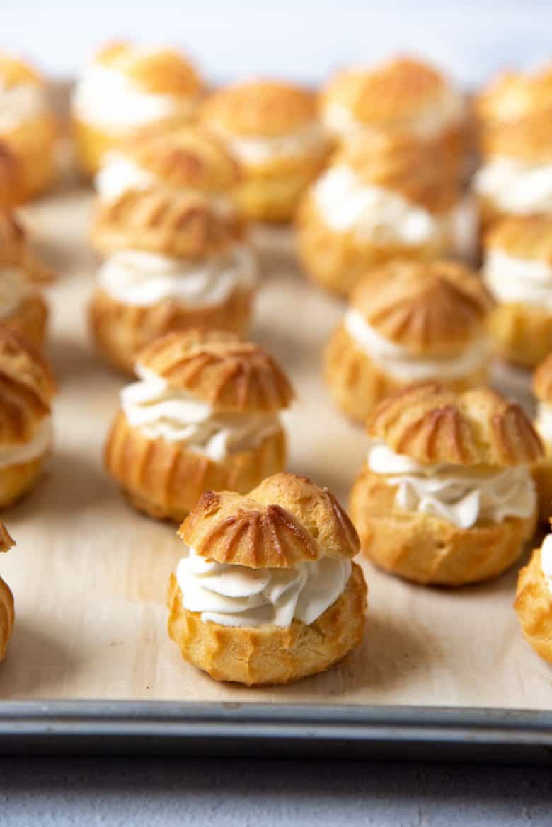 Filled choux pastries on a baking tray
