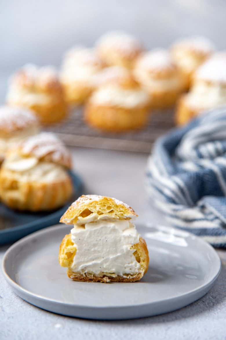 A cross section of a cream puff, with choux pastry filled with chantilly cream