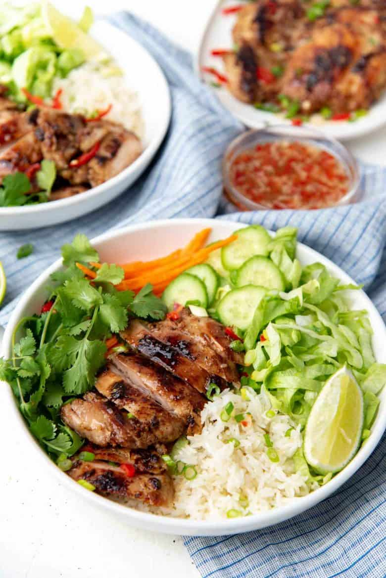 Lemongrass chicken serves with salad in a rice bowl
