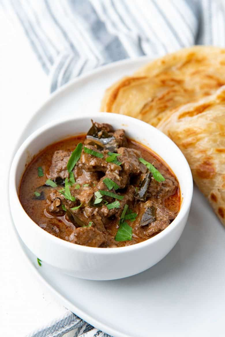 Beef curry served in a white bowl