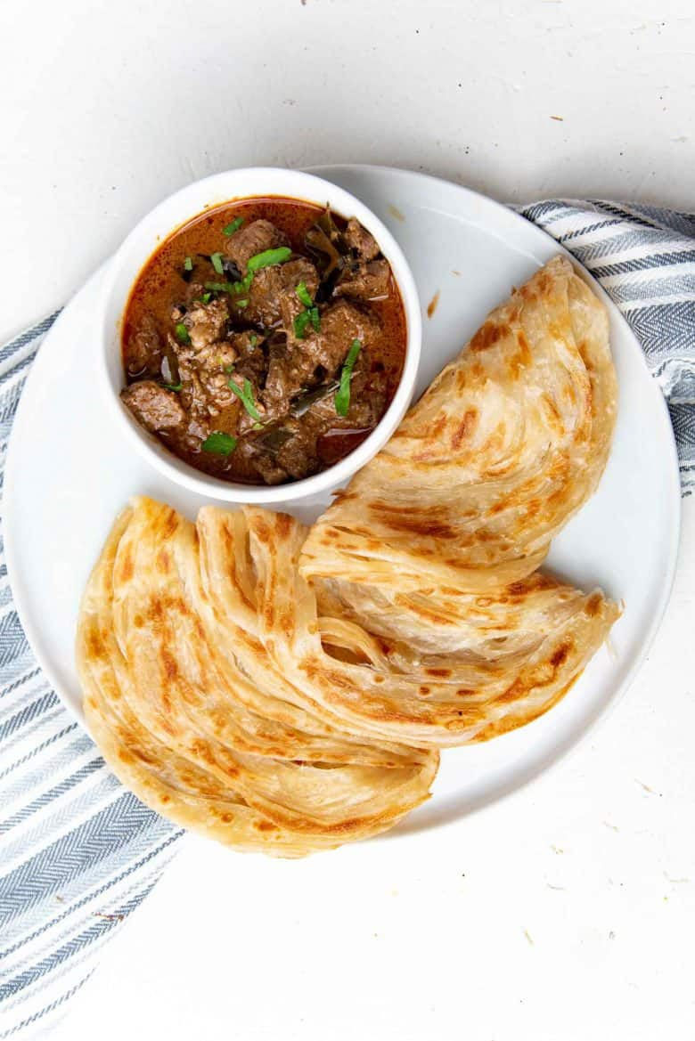 Beef curry overhead view with roti