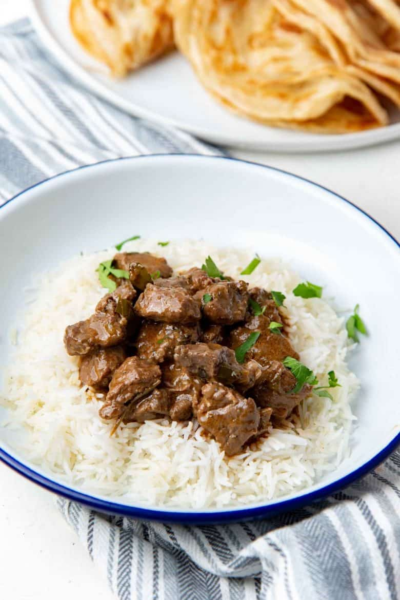 Beef curry served on a bed of white rice