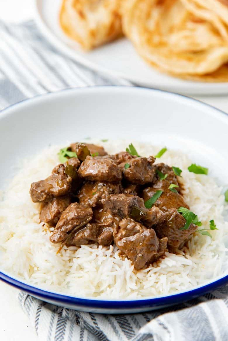 A close up of Sri Lankan beef curry served with rice