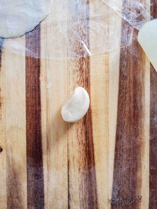 A portion of the dumpling dough on a worksurface