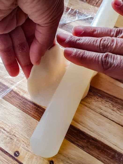 How to hold the wrapper while rolling it out, and rotating it to make dumpling wrappers