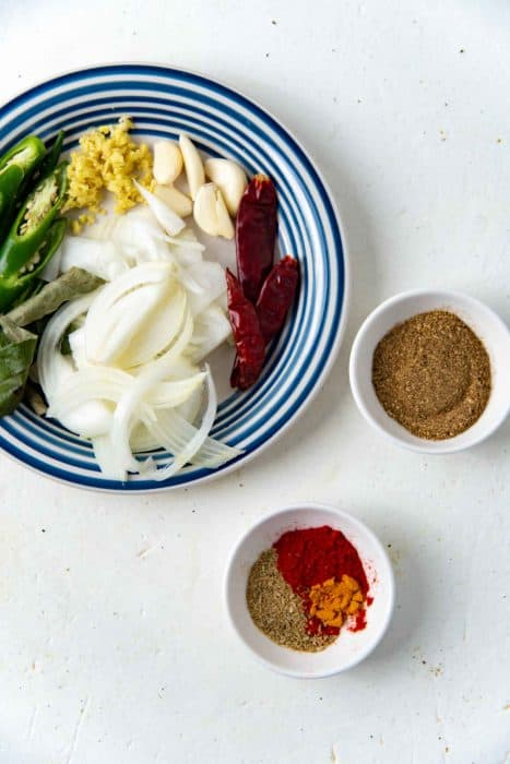 Ingredients and spices needed to make the mushroom curry