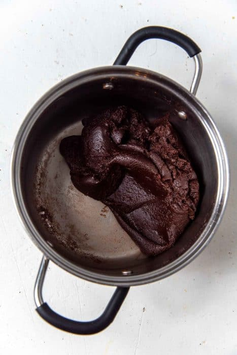 Overhead view of the chocolate choux dough after cooking in the pot