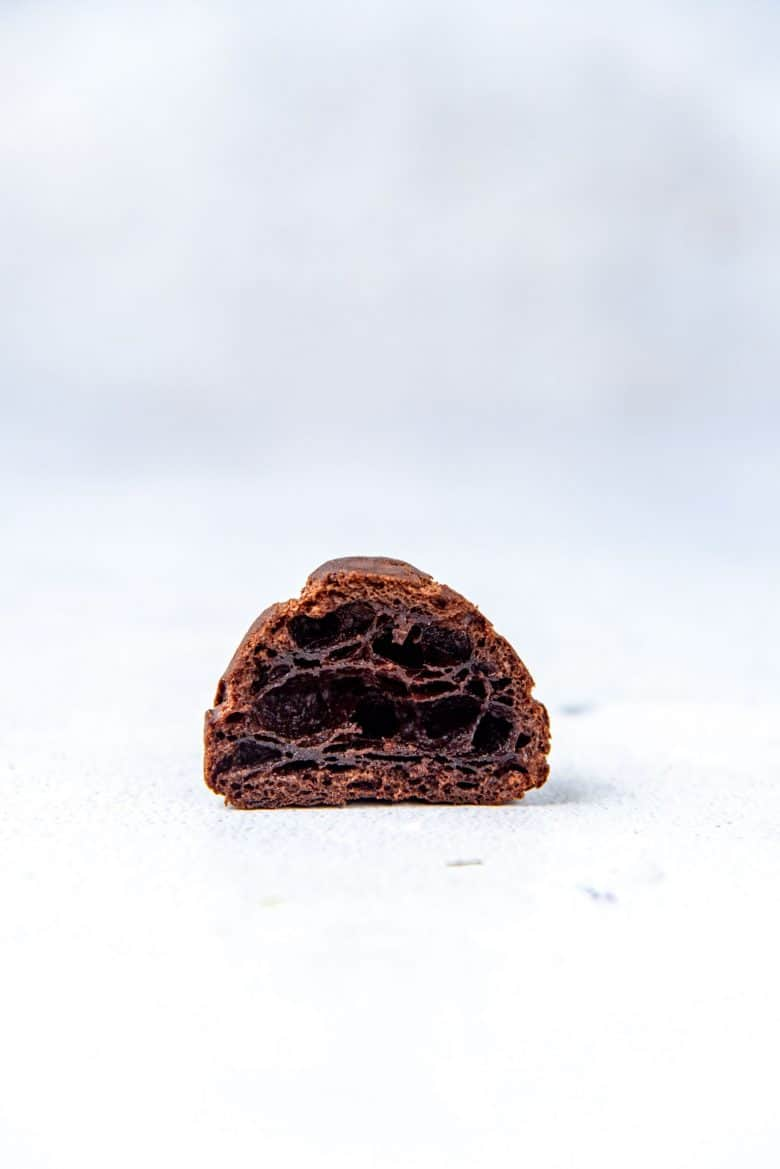 A cross section of the chocolate choux pastry puffs