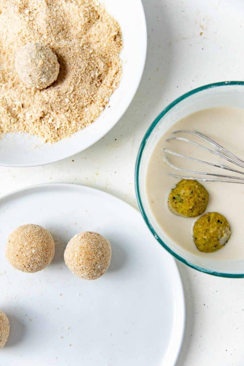 Dredging the jackfruit balls in the flour mix and breadcrumbs