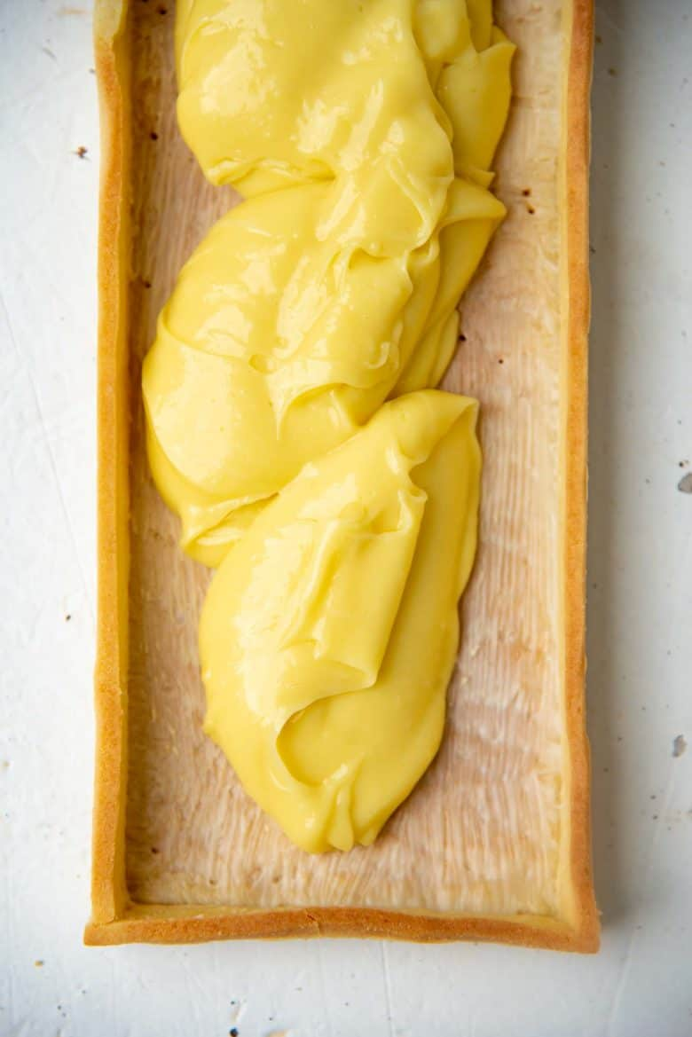 Filling the tart shell with pineapple curd