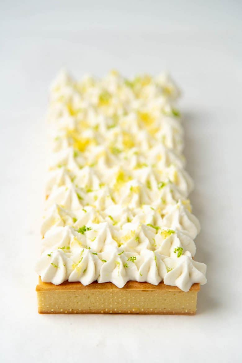 The tart decorated with lemon and lime zest
