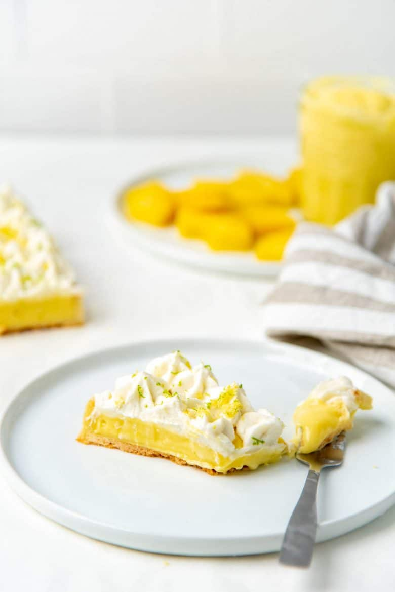 A slice of the pina colada tart, showing the creamy pineapple filling
